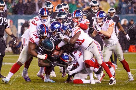 Philadelphia Eagles running back Jay Ajayi (28) gets tackled by the New York Giants defense during the NFL game between the New York Giants and the Philadelphia Eagles at Lincoln Financial Field in Philadelphia, Pennsylvania