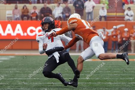 Stock Photo of Brandon Jones, Jett Duffy. Texas defensive back Brandon Jones hits Texas Tech quarterback Jett Duffy (7) during the first half of an NCAA college football game, in Austin, Texas