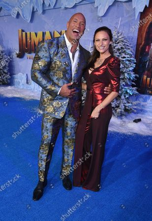Stock Photo of Dwayne Johnson and Lauren Hashian at the World Premiere of Columbia Pictures' JUMANJI: THE NEXT LEVEL at the TLC Chinese Theater.