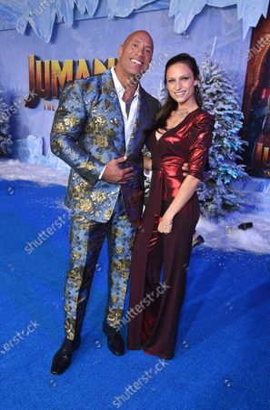 Dwayne Johnson and Lauren Hashian at the World Premiere of Columbia Pictures' JUMANJI: THE NEXT LEVEL at the TLC Chinese Theater.