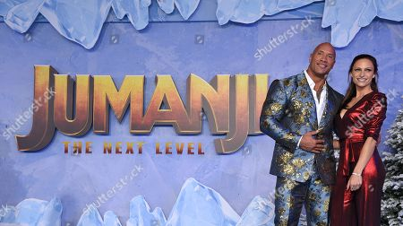 Stock Picture of Dwayne Johnson and Lauren Hashian at the World Premiere of Columbia Pictures' JUMANJI: THE NEXT LEVEL at the TLC Chinese Theater.
