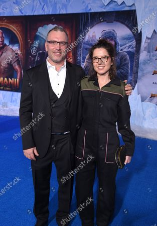 Henry Jackman and Victoria De La Vega at the World Premiere of Columbia Pictures' JUMANJI: THE NEXT LEVEL at the TLC Chinese Theater.