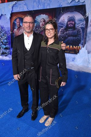 Stock Picture of Henry Jackman and Victoria De La Vega at the World Premiere of Columbia Pictures' JUMANJI: THE NEXT LEVEL at the TLC Chinese Theater.