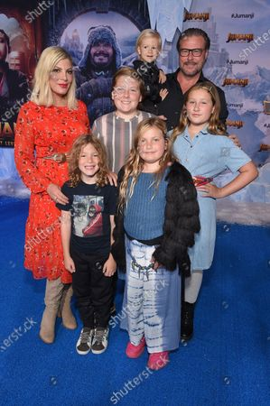Stock Photo of Tori Spelling, Finn McDermott, Hattie McDermott, Dean McDermott, Stella McDermott and Beau McDermott at the World Premiere of Columbia Pictures' JUMANJI: THE NEXT LEVEL at the TLC Chinese Theater.