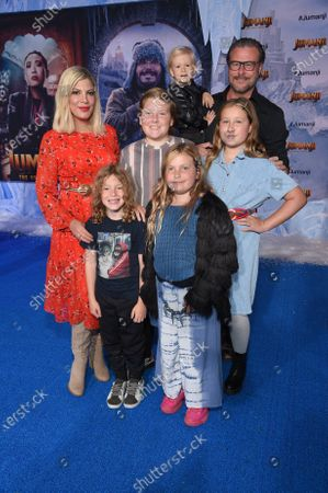 Stock Picture of Tori Spelling, Finn McDermott, Hattie McDermott, Dean McDermott, Stella McDermott and Beau McDermott at the World Premiere of Columbia Pictures' JUMANJI: THE NEXT LEVEL at the TLC Chinese Theater.