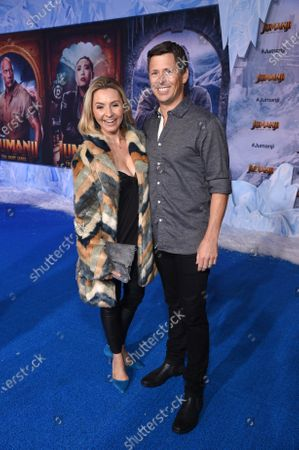 Stock Image of Beverley Mitchell and Michael Cameron at the World Premiere of Columbia Pictures' JUMANJI: THE NEXT LEVEL at the TLC Chinese Theater.