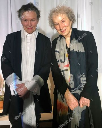 Laurie Anderson, Margaret Atwood. American avant-garde artist, composer, musician and film director Laurie Anderson, left, and Canadian author Margaret Atwood pose for photographs before speaking together at an event sponsored by the MacDowell Colony, in New York