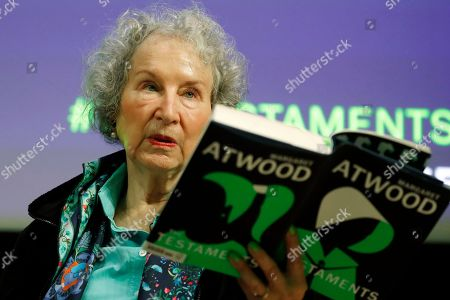 """Stock Photo of Canadian author Margaret Atwood holds a copy of her new book """"The Testaments,"""" during a news conference at the book's launch in London. Atwood is in conversation with American avant-garde artist, composer, musician and film director Laurie Anderson, at an event sponsored by the MacDowell artist colony in New York"""