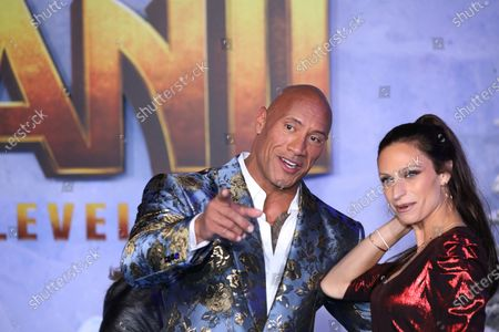 Dwayne Johnson (L) poses on the red carpet with singer Lauren Hashian (R) prior to the premiere of the movie 'Jumanji: The Next Level' at the TCL Chinese Theater in Los Angeles, California, USA, 09 December 2019. The movie will be released in US theaters on 13 December.