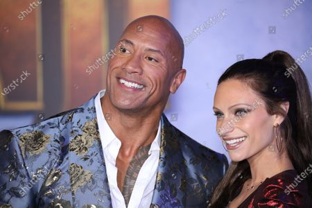 Dwayne Johnson (L) poses on the red carpet with his wife, US singer Lauren Hashian (R), prior to the premiere of the movie 'Jumanji: The Next Level' at the TCL Chinese Theater in Los Angeles, California, USA, 09 December 2019. The movie will be released in US theaters on 13 December.