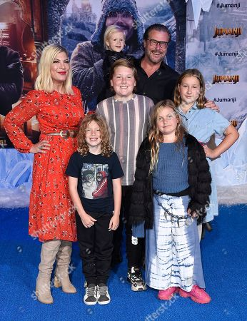 """Tori Spelling, Finn McDermott, Hattie McDermott, Dean McDermott, Stella McDermott and Beau McDermott. Tori Spelling and Dean McDermott arrive with their family at the Los Angeles premiere of """"Jumanji: The Next Level"""" at the TCL Chinese Theatre on in Calif"""