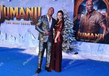 "Dwayne Johnson, Lauren Hashian. Cast member Dwayne Johnson, left, arrives with Lauren Hashian at the Los Angeles premiere of ""Jumanji: The Next Level,"" at the TCL Chinese Theatre"