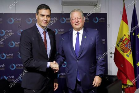 Acting Spanish Prime Minister Pedro Sanchez (L) and former US Vice President Al Gore (R) pose during their meeting in the framework of the COP25 UN Climate Change Conference in Madrid, Spain, 10 December 2019. The summit runs in the Spanish capital until 13 December.