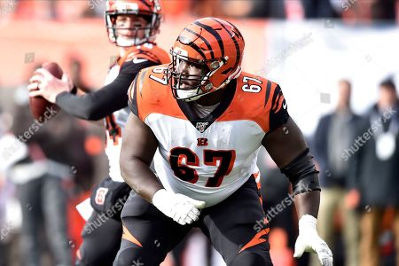 Cincinnati Bengals offensive guard John Miller (67) blocks during an NFL football game against the Cleveland Browns, in Cleveland. The Browns won 27-19