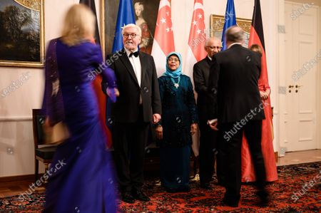 German President Frank-Walter Steinmeier (L) and his wife Elke Buedenbender (R) and Singapore President Halimah Yacob (3-L) and her husband Mohammed Abdullah Alhabshee (4-L) welcome guests for a state banquet at Bellevue Palace in Berlin, Germany, 10 December 2019. German President Frank-Walter Steinmeier and his wife Elke Buedenbender welcomed guests in honor of the visit of Singapore President Halimah Yacob and her husband Mohammed Abdullah Alhabshee.