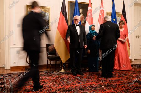 Stock Photo of German President Frank-Walter Steinmeier (2-L) and his wife Elke Buedenbender (R) and Singapore President Halimah Yacob (3-L) and her husband Mohammed Abdullah Alhabshee (4-L-covered) welcome guests for a state banquet at Bellevue Palace in Berlin, Germany, 10 December 2019. German President Frank-Walter Steinmeier and his wife Elke Buedenbender welcomed guests in honor of the visit of Singapore President Halimah Yacob and her husband Mohammed Abdullah Alhabshee.