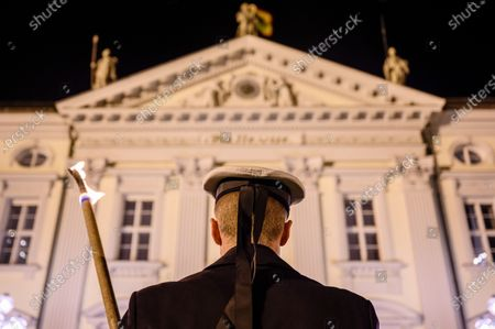A torchbearer stands among others in front of Bellevue Palace on the occasion of a state banquet given by German President Frank-Walter Steinmeier and his wife Elke Buedenbender (both not in the picture) for Singapore President Halimah Yacob and her husband Mohammed Abdullah Alhabshee (both not in the picture) in Berlin, Germany, 10 December 2019. German President Frank-Walter Steinmeier and his wife Elke Buedenbender welcomed guests in honor of the visit of Singapore President Halimah Yacob and her husband Mohammed Abdullah Alhabshee.