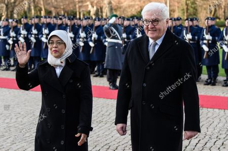 German President Frank-Walter Steinmeier (R) and Singapore President Halimah Yacob walk next to each other during a ceremony with military honors in the yard of Bellevue Palace in Berlin, Germany, 10 December 2019. President Halimah Yacob is on a five-day state visit to Germany, the first by a Singapore head of state to the country.