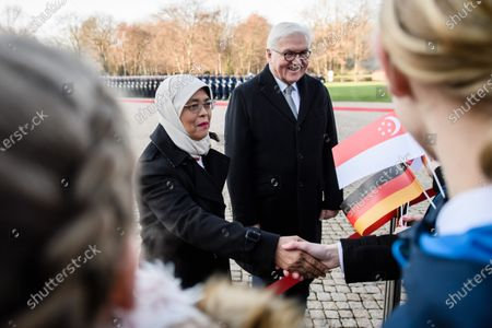 German President Frank-Walter Steinmeier (R) and Singapore President Halimah Yacob (L) shake hands with pupils during a ceremony with military honors in the yard of Bellevue Palace in Berlin, Germany, 10 December 2019. President Halimah Yacob is on a five-day state visit to Germany, the first by a Singapore head of state to the country.