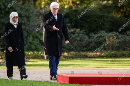 German President Frank-Walter Steinmeier (R) and Singapore President Halimah Yacob walk walk next to each other during a ceremony with military honors in the yard of Bellevue Palace in Berlin, Germany, 10 December 2019. President Halimah Yacob is on a five-day state visit to Germany, the first by a Singapore head of state to the country.