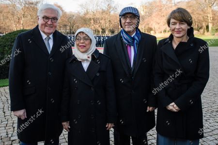 German President Frank-Walter Steinmeier (L) and his wife Elke Buedenbender (R) with Singapore President Halimah Yacob (2-L) and her husband Mohammed Abdullah Alhabshee (3-L) pose for photographers during a ceremony with military honors in the yard of Bellevue Palace in Berlin, Germany, 10 December 2019. President Halimah Yacob is on a five-day state visit to Germany, the first by a Singapore head of state to the country.