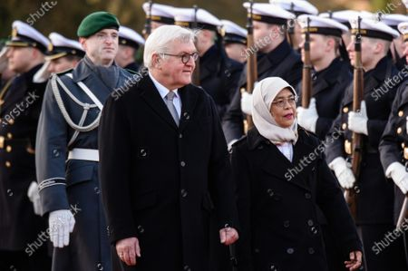 German President Frank-Walter Steinmeier (2-L) and Singapore President Halimah Yacob walk walk next to each other during a ceremony with military honors in the yard of Bellevue Palace in Berlin, Germany, 10 December 2019. President Halimah Yacob is on a five-day state visit to Germany, the first by a Singapore head of state to the country.