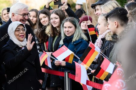 Singapore President Halimah Yacob (L-front) waves next to German President Frank-Walter Steinmeier (L-back) towards attending pupils during a ceremony with military honors in the yard of Bellevue Palace in Berlin, Germany, 10 December 2019. President Halimah Yacob is on a five-day state visit to Germany, the first by a Singapore head of state to the country.