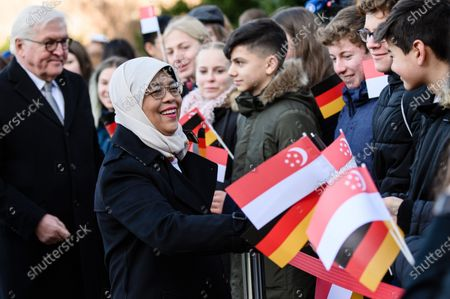 Singapore President Halimah Yacob (2-L) shakes hands with pupils next to German President Frank-Walter Steinmeier (L) during a ceremony with military honors in the yard of Bellevue Palace in Berlin, Germany, 10 December 2019. President Halimah Yacob is on a five-day state visit to Germany, the first by a Singapore head of state to the country.