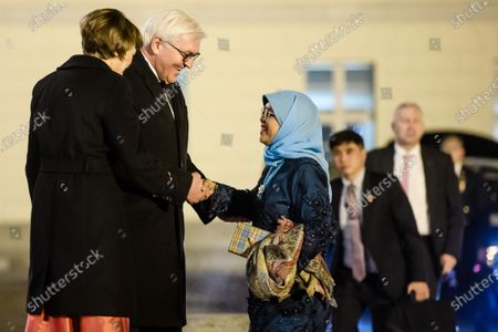 German President Frank-Walter Steinmeier (2-L) and his wife Elke Buedenbender (L) welcome Singapore President Halimah Yacob (3-L) for a state banquet at Bellevue Palace in Berlin, Germany, 10 December 2019. German President Frank-Walter Steinmeier and his wife Elke Buedenbender welcomed guests in honor of the visit of Singapore President Halimah Yacob and her husband Mohammed Abdullah Alhabshee.