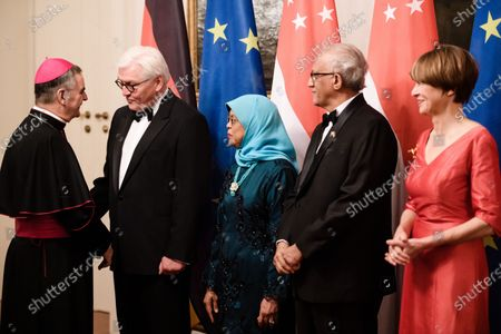 German President Frank-Walter Steinmeier (2-L) welcomes the Apostolic Nuncio Archbishop Nikola Eterovic (L) on the occasion of a state banquet given for Singapore President Halimah Yacob (3-L) and her husband Mohammed Abdullah Alhabshee (4-L), next to the the wife of German President Frank-Walter Steinmeier, Elke Buedenbender (R), at Bellevue Palace in Berlin, Germany, 10 December 2019. German President Frank-Walter Steinmeier and his wife Elke Buedenbender welcomed guests in honor of the visit of Singapore President Halimah Yacob and her husband Mohammed Abdullah Alhabshee.
