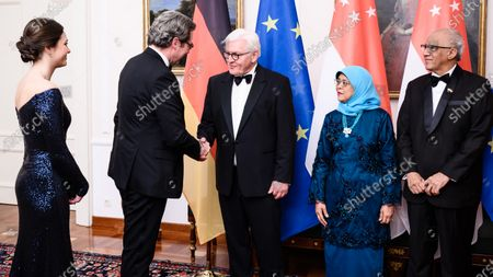 German President Frank-Walter Steinmeier (3-L) welcomes German Minister of Transport and Digital Infrastructure Andreas Scheuer (2-L) and his girlfriend Julia Reuss (L) on the occasion of a state banquet given for Singapore President Halimah Yacob (4-L) and her husband Mohammed Abdullah Alhabshee (R) at Bellevue Palace in Berlin, Germany, 10 December 2019. German President Frank-Walter Steinmeier and his wife Elke Buedenbender welcomed guests in honor of the visit of Singapore President Halimah Yacob and her husband Mohammed Abdullah Alhabshee.