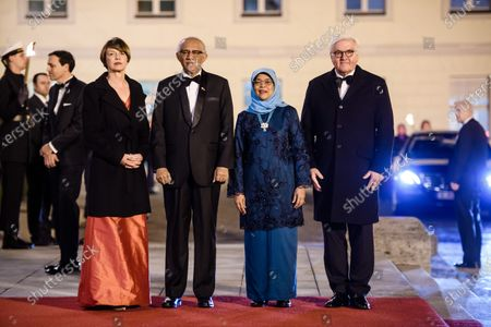 German President Frank-Walter Steinmeier (R), his wife Elke Buedenbender (L), Singapore President Halimah Yacob (3-L) and her husband Mohammed Abdullah Alhabshee pose for media on the occasion of a state banquet at Bellevue Palace in Berlin, Germany, 10 December 2019. German President Frank-Walter Steinmeier and his wife Elke Buedenbender welcomed guests in honor of the visit of Singapore President Halimah Yacob and her husband Mohammed Abdullah Alhabshee.