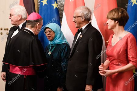 The Apostolic Nuncio Archbishop Nikola Eterovic (2-L) and Singapore President Halimah Yacob (3-L) shake hands next to Singapore President's husband Mohammed Abdullah Alhabshee (4-L), and German President Frank-Walter Steinmeier (L) and his wife Elke Buedenbender (R) on the occasion of a state banquet at Bellevue Palace in Berlin, Germany, 10 December 2019. German President Frank-Walter Steinmeier and his wife Elke Buedenbender welcomed guests in honor of the visit of Singapore President Halimah Yacob and her husband Mohammed Abdullah Alhabshee.