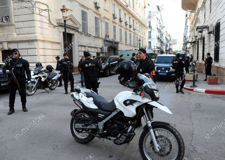 Members of Algeria's Research and Intervention Brigades (BRI) stand guard as a vehicle carrying two former prime ministers leaves the court building, in Algiers, Algeria, 10 December 2019. The two former Prime Ministers Abdelmalek Sellal and Ahmed Ouyahia are currently under trial on charges of money laundering and corruption.
