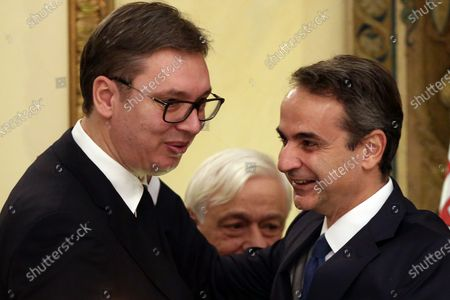 Serbian President Aleksandar Vucic (L) and Greek Premier Kyriakos Mitsotakis (R) talk as Greek President Prokopis Pavlopoulos (C) looks on during the official dinner at the Presidential Mansion in Athens, Greece, 10 December 2019. Vucic is in Greece on a two-day official visit.