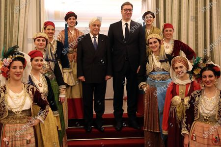 Greek President Prokopis Pavlopoulos (L) and his Serbian counterpart Aleksandar Vucic (R) pose with girls wearing traditional dresses during the official dinner at the Presidential Mansion in Athens, Greece, 10 December 2019. Vucic is in Greece on a two-day official visit.