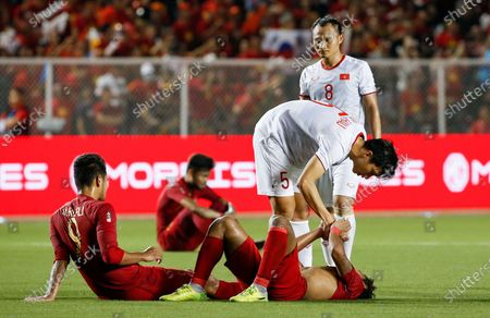 Stock Picture of Van Hau Doan (C-top) of Vietnam consoles Ardiles Osvaldo Haay (C-bottom) of Indonesia after the Men's soccer final match at the Southeast Asian (SEA) Games in Manila, Philippines, 10 December 2019.