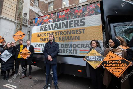Tom Brake, Liberal Democrat Shadow Brexit Secretary, launches the party's final campaign poster in Westminster.
