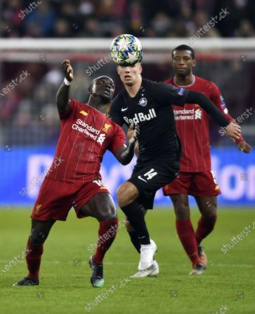Sadio Mane of Liverpool FC (L) and Dominik Szoboszlai of FC Salzburg (R) in action during the UEFA Champions League group E soccer match between FC Salzburg and Liverpool FC in Salzburg, Austria, 10 December 2019.