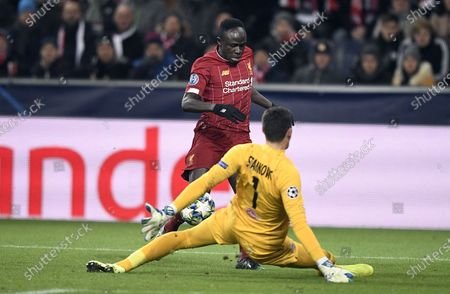 Sadio Mane of Liverpool FC (back) and Cican Stankovic of FC Salzburg (down) in action during the UEFA Champions League group E soccer match between FC Salzburg and Liverpool FC in Salzburg, Austria, 10 December 2019.