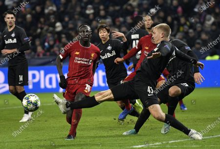 Rasmus Kristensen of FC Salzburg (R) clears ahead Sadio Mane of Liverpool FC (CL) during the UEFA Champions League group E soccer match between FC Salzburg and Liverpool FC in Salzburg, Austria, 10 December 2019.
