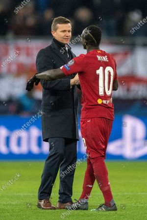 Head coach Jesse Marsch of FC Salzburg (L) and Sadio Mane of Liverpool FC (R) after the UEFA Champions League group E soccer match between FC Salzburg and Liverpool FC in Salzburg, Austria, 10 December 2019.