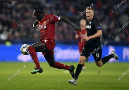 Rasmus Kristensen of FC Salzburg (R) and Sadio Mane of Liverpool FC (L) in action during the UEFA Champions League group E soccer match between FC Salzburg and Liverpool FC in Salzburg, Austria, 10 December 2019.