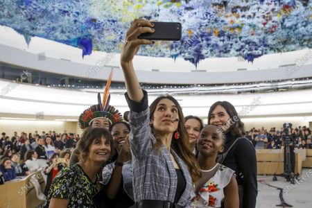 Nobel Peace Prize 2018 Nadia Murad (C) takes a selfie with (L-R) moderator Tania Chytil; Brazilian Hamangai Pataxo, activist for the rights of indigenous peoples; Congolese activist Rebecca Kabuo; British sisters and activists Ella Meek and Amy Meek and Malawian child rights activist Memory Banda at the end of the Young Activists Summit (YAS19) at the European headquarters of the United Nations (UNOG) in Geneva, Switzerland, 10 December 2019.
