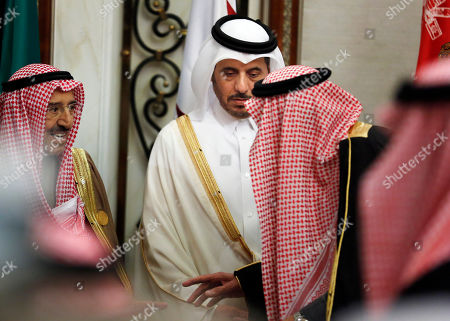 King Salman, Sabah Al Ahmad Al Sabah. Qatar's Prime Minister Abdullah bin Nasser bin Khalifa al-Thani, center, looks at Saudi King Salman, right, as he talks to Kuwait's emir, Sheikh Sabah Al Ahmad Al Sabah, left, during the 40th Gulf Cooperation Council Summit in Riyadh, Saudi Arabia