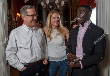 Stock Picture of Reggie Nelson.  . 15. 11. 18 Quintin And Elizabeth Price With Reggie Nelson.  A Determined Reggie Door-knocked His Way To A Top Job In The City By Googling 'Richest Area In London' And Came Up With Gloucester Road In Kensington Then Went With A Prepared Speech To Ask The Residents How They Did It.  Words: Kathryn Knight. 15. 11. 18.