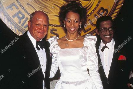 Don Rickles Altovise Davis and Sammy Davis Jr at the Friars Club in New York City 05-1988