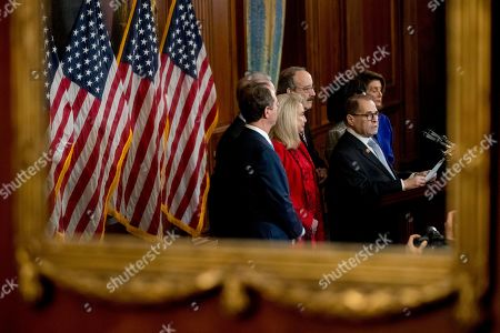 Jerrold Nadler, Adam Schiff, Eliot Engel, Carolyn Maloney. As seen in reflection, Chairman of the House Committee on the Judiciary Jerrold Nadler, D-N.Y., second from right, accompanied by House Speaker Nancy Pelosi of Calif., right, Chairman of the House Intelligence Committee Adam Schiff, D-Calif., left, Chairman of the House Foreign Affairs Committee Eliot Engel, D-N.Y., third from left, Chairwoman of the House Oversight and Reform Committee Carolyn Maloney, D-N.Y., second from left, speaks at a news conference to unveil articles of impeachment against President Donald Trump, abuse of power and obstruction of Congress, on Capitol Hill in Washington