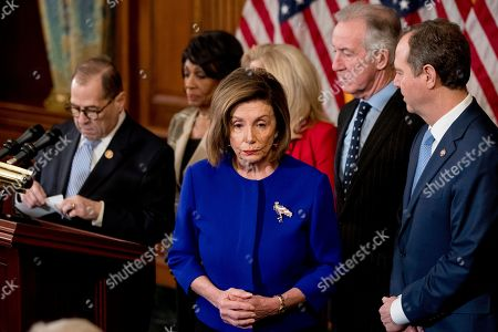 Jerrold Nadler, Adam Schiff, Maxine Waters, Carolyn Maloney, Richard Neil, Nancy Pelosi. House Speaker Nancy Pelosi of Calif., center, accompanied by Chairman of the House Judiciary Committee Jerrold Nadler, D-N.Y., left, Chairwoman of the House Financial Services Committee Maxine Waters, D-Calif., second from left, Chairwoman of the House Oversight and Reform Committee Carolyn Maloney, D-N.Y., third from right, Chairman of the House Ways and Means Committee Richard Neal, D-Mass., second from right, and Chairman of the House Intelligence Committee Adam Schiff, D-Calif., right, appear at a news conference to unveil articles of impeachment against President Donald Trump, abuse of power and obstruction of Congress, on Capitol Hill in Washington