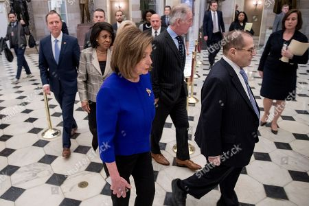 Jerrold Nadler, Adam Schiff, Maxine Waters, Carolyn Maloney, Richard Neil, Nancy Pelosi. House Speaker Nancy Pelosi of Calif., with from left, Chairman of the House Intelligence Committee Adam Schiff, D-Calif., Chairwoman of the House Financial Services Committee Maxine Waters, D-Calif., Pelosi, Chairman of the House Ways and Means Committee Richard Neal, D-Mass., and Chairman of the House Judiciary Committee Jerrold Nadler, D-N.Y., walk to a news conference to unveil articles of impeachment against President Donald Trump, abuse of power and obstruction of Congress, on Capitol Hill in Washington